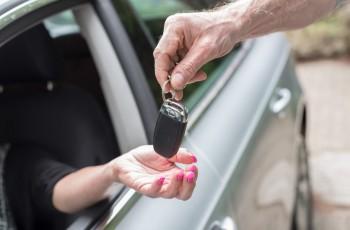 Woman getting his car keys